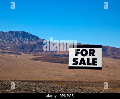 For Sale Sign in Desert - Stock Image