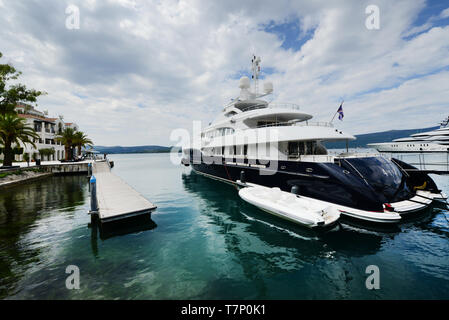 The Luxury yacht marina with the modern apartment complex of Porto Montenegro in Tivat. - Stock Image