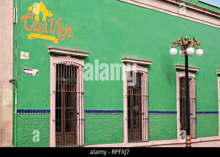 Bright green walls of the Casa Vieja restaurant and bar in the state capital of San Luis Potosi, Mexico. - Stock Image