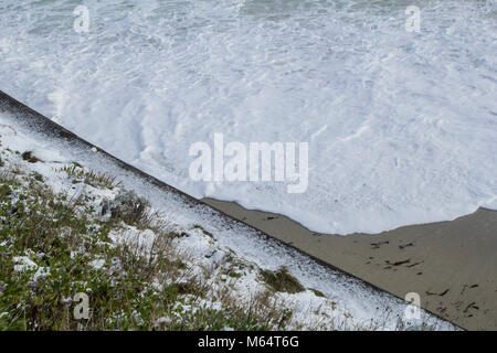 Stormy weather sends snow to the coast of Falmouth - Stock Image