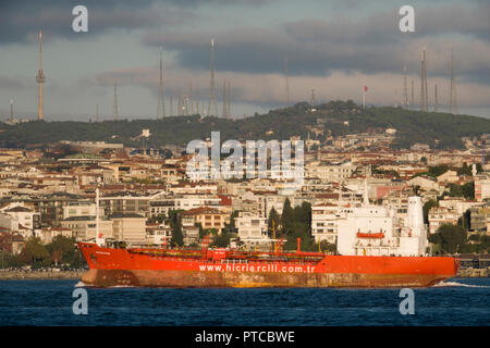 Cargo ship travels through the Bosphorus in Istanbul, Turkey - Stock Image