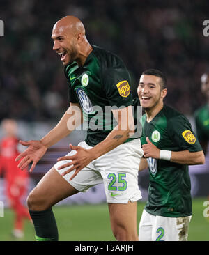 22 April 2019, Lower Saxony, Wolfsburg: Soccer: Bundesliga, 30th matchday: VfL Wolfsburg - Eintracht Frankfurt in the Volkswagen Arena. Wolfsburg's John Anthony Brooks (l) cheers his goal to 1:1 against Eintracht Frankfurt with William. Photo: Peter Steffen/dpa - IMPORTANT NOTE: In accordance with the requirements of the DFL Deutsche Fußball Liga or the DFB Deutscher Fußball-Bund, it is prohibited to use or have used photographs taken in the stadium and/or the match in the form of sequence images and/or video-like photo sequences. - Stock Image