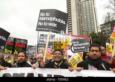 London, UK - 16 March 2019:  Muslim men holding placards seen taking part in the UN Anti-Racism Day demonstration that took place in central London on 16 March. The demonstration which began in Park Lank and ended outside Downing Street was organised by Stand Up to Racism and Love Music Hate Racism and supported by the TUC and UNISON. Photo: David Mbiyu Credit: david mbiyu/Alamy Live News - Stock Image