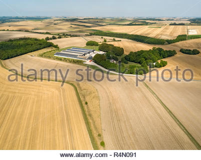 Aerial landscape of harvested summer farm wheat and barley fields - Stock Image