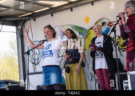 London, UK. 17th April 2019. Poests and storytellers wait to perform on the lorry stage. Two days after Extinction Rebellion closed Waterloo Bridge turning it into a 'Garden Bridge' it remains closed to traffic despite a couple of hundred arrests. Activities continue on the bridge with new protesters arriving. Credit: Peter Marshall/Alamy Live News - Stock Image