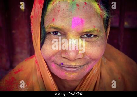Portrait of Hindu widow woman during Holi living in an ashram in Vrindavan , India - Stock Image