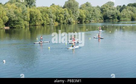 Paddle boards on lake Milton Park - Stock Image
