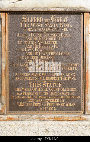 The plaque that details King Alfred the Greats achievements and which sits at the base of his statue in Wantage, - Stock Image
