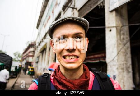 Face expression, a young man in a strange street. - Stock Image