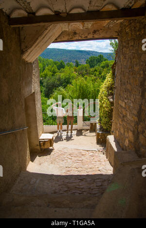 Man at the viewpoint with sculpture. Cañete, Cuenca province, Castilla La Mancha, Spain. - Stock Image