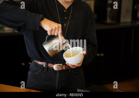 Barista Pouring Espresso Drink Latte at Coffee Shop - Stock Image