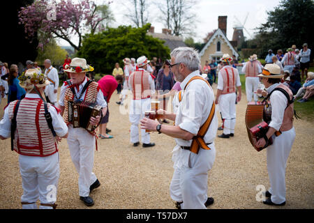 Thaxted Essex England, UK. 22nd Apr, 2019. Traditional Easter Bank Holiday Monday Morris Dancing in Thaxted Church Yard. Thaxted Morris in red and white along with guest side Devils Dyke Morris side from Cambridgeshire entertain the crowd in the sopring sunshine. Credit: BRIAN HARRIS/Alamy Live News - Stock Image
