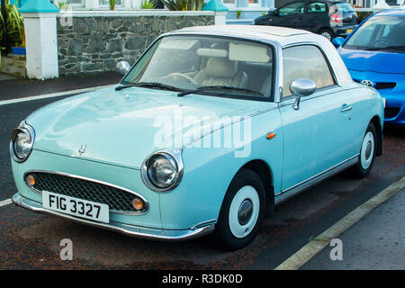 11 October 2018 A Classis Nissan Figaro automatic convertible car with mint chrome trim parked on the Seacliff Road in Bangor County Down Northern Ire - Stock Image