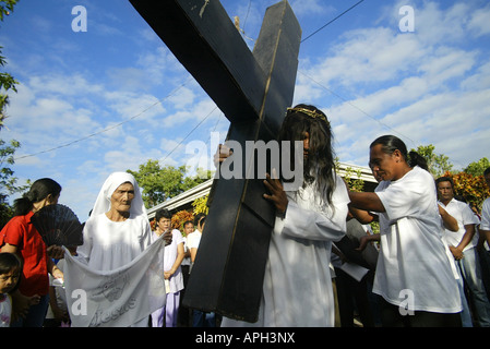 A Filipino portraying Jesus Christ leads a Good Friday procession in Mansalay, Oriental Mindoro, Philippines. - Stock Image