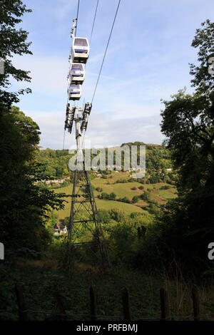 View of cable cars from a walking path at The Height of Abraham, Matlock Bath, UK. unsharpened - Stock Image