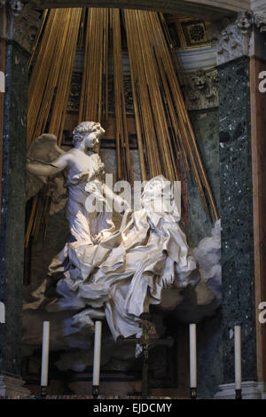 Ecstasy of Saint Teresa. Baroque statue by Gian Lorenzo Bernini in the Church of Santa Maria della Vittoria in Rome, - Stock Image