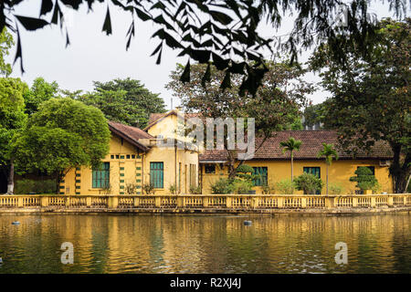 View across lake to house no 54 where President Ho Chi Minh lived in Presidential Palace grounds. Hanoi, Vietnam, Asia - Stock Image