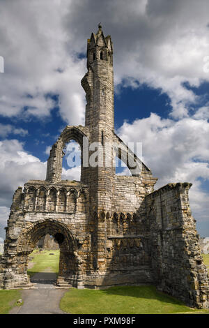Sun on stone ruins of the 14th Century West Entrance and tower of St Andrews Cathedral with clouds St Andrews Fife Scotland UK - Stock Image