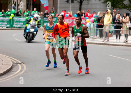 Jorge Pina (POR), and Matthew Felton (AUS), competing in the 2019 World Para  London Marathon.  Jorge finished 8th in the T11/12 Category, in a time of 02:45:35.  Matthew finished 6th in the T45/46 Category in a time of 02:45:3. - Stock Image