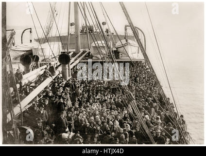 Immigrants to the United States on the deck of the German steamship SS Patricia operated by the Hamburg America - Stock Image