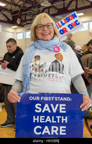 Westbury, USA. January 15, 2017.  Nancy Berger, of Merrick, is holding an 'Our First Stand: Save Health Care' - Stock Image