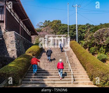 27 March 2019: Gamagori, Japan - Visitors climbing the steps to the Katahara Shrine, Gamagori. - Stock Image