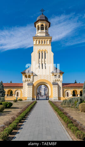 Beautiful view to the Coronation Reunification Cathedral Bell Tower in Alba Iulia city, Romania. A Bell Tower on a sunny day in Alba Iulia, Romania. - Stock Image