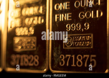 Fine solid gold 999.9 one ounce bullion ingot precious metals bar closeup isolated photo. - Stock Image