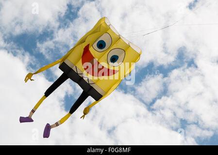 Portsmouth, UK. 15th August 2015. A large Spongebob Sqaurepants soft kite files at the International Kite Festival. - Stock Image