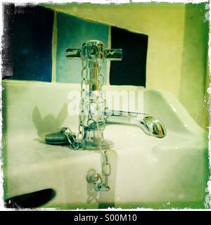 Shiney bathroom tap and wash basin - Stock Image