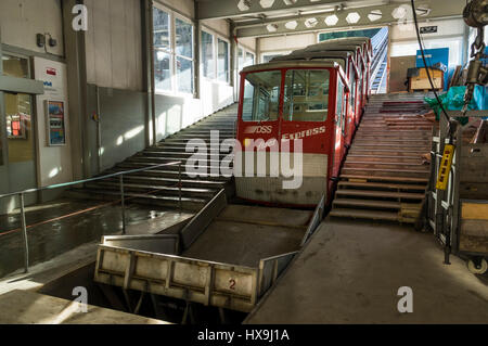 Red car of the old Schlattli-Stoos funicular in the valley station, ready for boarding. Schlattli, Canton of Schwyz, - Stock Image