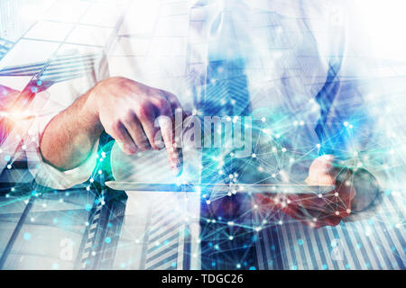 Businessman works with tablet. Concept of network technology. Double exposure with light effects - Stock Image
