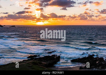 Sunset over waves and surf at Fistral Beach, Newquay, Cornwall, UK - Stock Image