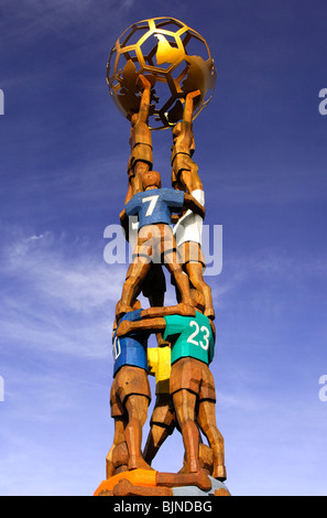 Soccer monument as a pyramid of soccer players holding a globe at the Home of FIFA, Zurich, Switzerland - Stock Image