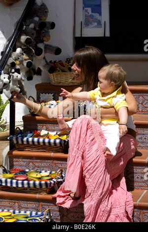 Mother and toddler shopping for soft toys, Mijas Pueblo, Costa del Sol,  Andalucia, Spain - Stock Image