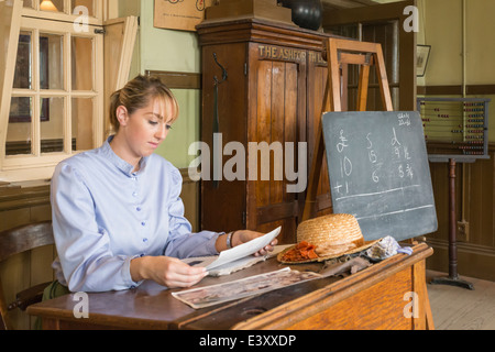 Lady Teacher in Classroom at Beamish Living Open Air Museum - Stock Image