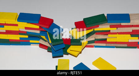 Color blocks from order to chaos and back; breach the wall (front cam, in). - Stock Image