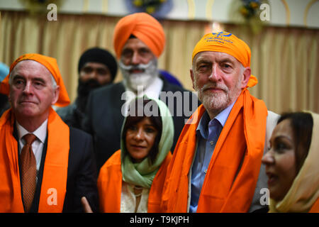 (left to right) Shadow Chancellor John McDonnell, Laura Alvarez, and Labour leader Jeremy Corbyn during a visit to Gurdwara Sri Guru Singh Sabha in Southall. - Stock Image