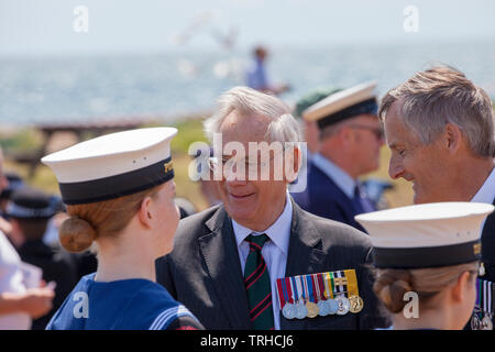 HRH The Duke of Gloucester talks to Sea Cadets at the D Day Commemoration on Hayling Island, 6th June 2019. D Day Commemoration at the COPP (Combined Operation Pilotage Parties) Memorial on the seafront on Hayling Island.  On 2 May 1944, Hayling Island seafront was used for practice amphibious landings, known as Exercise Fabius 2.   The COPP Unit was set up on Hayling Island under the instruction of Lord Mountbatten in 1943.  The Memorial is dedicated to the soldiers who trained as frogmen and canoeists for beach reconnaissance and other covert operations prior to the Allied landings on enemy - Stock Image