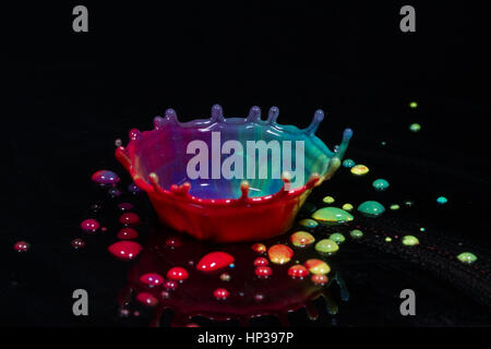 Liquid Art, the study of a liquid drop creating shapes from fluid the study of fluid dynamics - Stock Image
