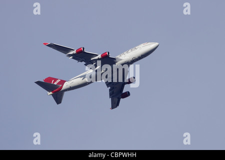 Virgin Atlantic Boeing 747-400 G-VROC in flight : overcast sky - Stock Image