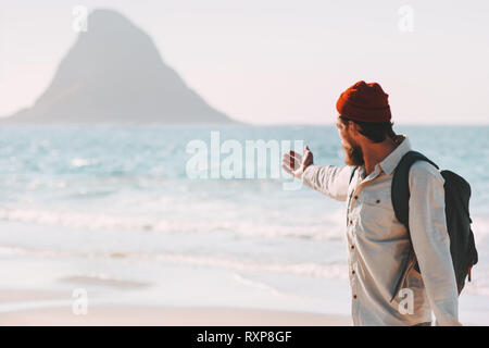 Man traveler showing sea landscape beach traveling healthy lifestyle adventure vacations in Norway summer journey outdoor - Stock Image