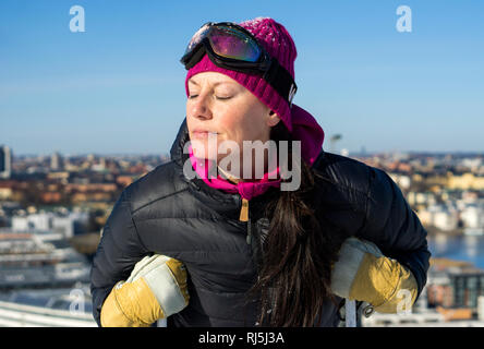 A woman skier - Stock Image