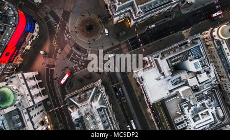 Bird's Eye View Flying Over Piccadilly Circus and Aerial View of London City Streets at Night in London England 4K - Stock Image