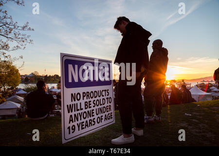 VANCOUVER, BC, CANADA - APR 20, 2019: A young man standing next to a vendor age restriction sign at the 420 festival in Vancouver. - Stock Image