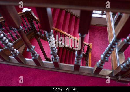 Victorian wooden staircase with a bright red carpet, Ramsgate. - Stock Image