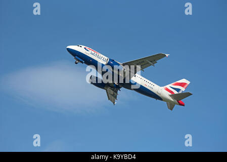 British Airways 319-131 flight departing Inverness for London Heathrow on its daily scheduled flight - Stock Image