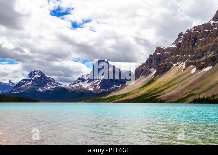 Bow Lake in Banff National Park, with Crowfoot Mountain and Crowfoot Glacier in the background. Located at the base of Bow Summit, the lake is fed by  - Stock Image