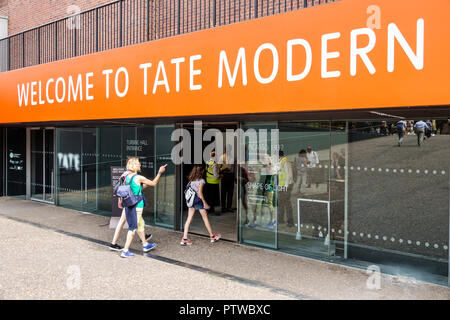 London England United Kingdom Great Britain Southwark Bankside Tate Modern contemporary art museum gallery entrance door welcome sign exterior outside - Stock Image