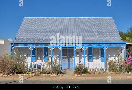 Traditional Karoo home architecture. Victorian blue and white house with tin roof. In Prince Albert, South Africa - Stock Image